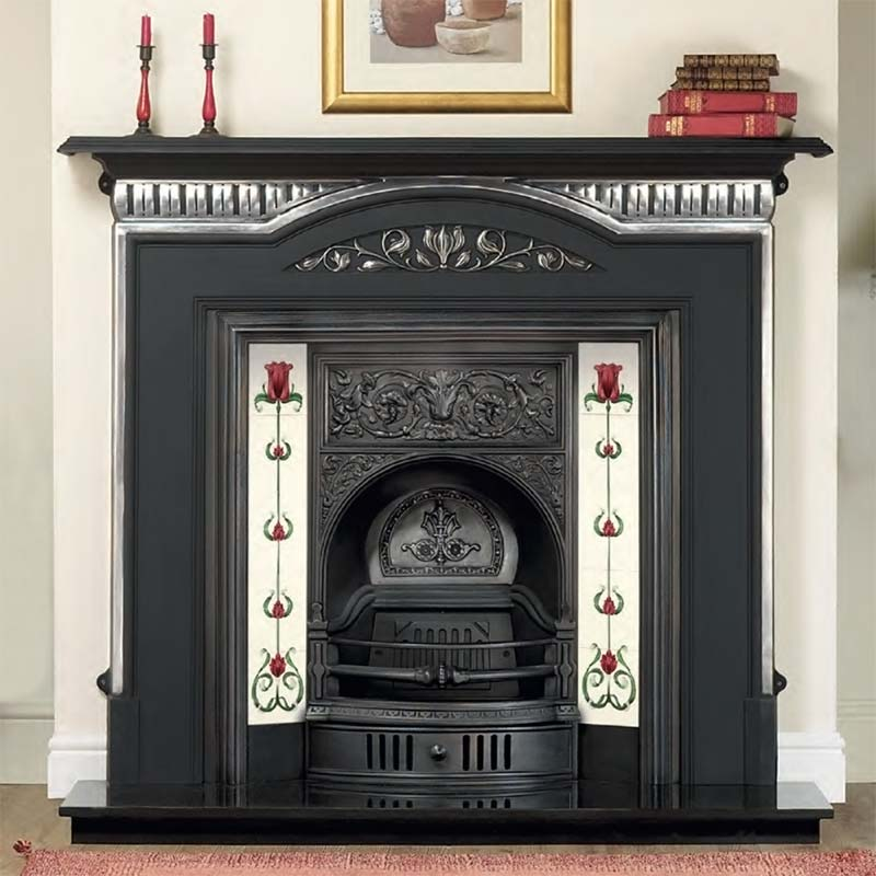 A cast iron fireplace insert with ornate detailing across the fireplace frieze and around the arched opening. It has tile sliders at either side of the fireplace opening. Suitable sets of tiles can be chosen from our Fireplace Tile website at http://www.f