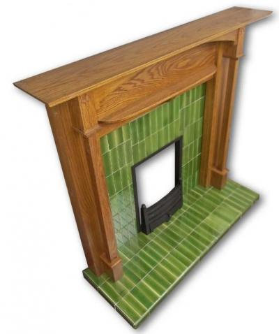 Voysey tiled fireplace insert from the side